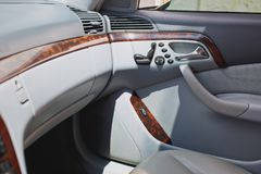 Old luxury modern car interior, beige color, electronic buttons, automatic transmission lever.  royalty free stock images