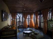 Old luxury room, yellow curtains royalty free stock images