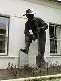 Old Mac. A statue in Stellenbosch.nnA Cape Dutch building in Dorp Street, Stellenbosch with a bronze statue of �Old Mac` outside. The statue was royalty free stock photos