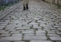 Free Old Macadam Street With Lonely Walker S Legs As A Background Stock Images - 68597134