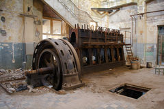 Old machine. In an abandoned factory building Royalty Free Stock Photo