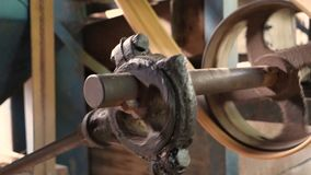 The old machine for agriculture working by the belt pulley and rotary gear spinning. 4K The old machine for agriculture working by the belt pulley and rotary stock footage