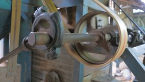 The old machine for agriculture working by the belt pulley and rotary gear spinning. 4K The old machine for agriculture working by the belt pulley and rotary stock video