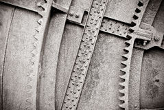 Old machine with gears and rivets Royalty Free Stock Images