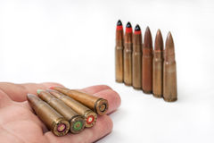 Old machine gun bullets in the hand Stock Photo