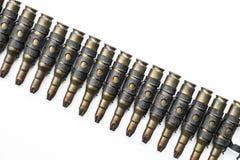 Old machine gun's bullets on white background Stock Photo