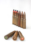 Old machine guns bullets on the white background Stock Photography