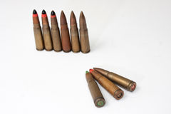 Old machine guns bullets on the white background Royalty Free Stock Image
