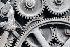 Old machinery: gear and metal cogwheels. Old machinery: gear, metal cogwheels, nuts and bolts. Everything is working fine since a lot of time ago Stock Photos