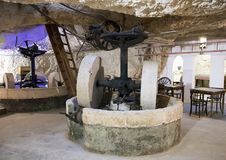 Old machinery for olive oil manufacture at Masseria Il Frantoio, Southern Italy. Pictured is old machinery for olive oil manufacture on display at Masseria Il Royalty Free Stock Photo