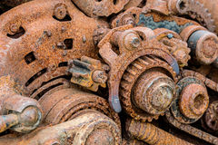 Old machinery parts. corroded metal gearwheels closeup. Stock Photos
