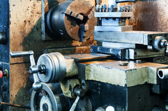 The old machines in the factory. Ery old gear, factory waste machines Stock Image