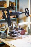 Old machines in a shoemaker workshop. Sewing, decorative Royalty Free Stock Photos