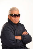 The old mafia boss. Old man sits in a jacket and glasses Royalty Free Stock Photos