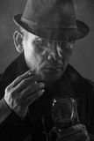 Old mafia boss portrayed in noir style Royalty Free Stock Photos