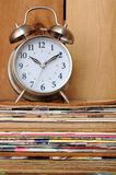 Old magazine and old bell clock Royalty Free Stock Image