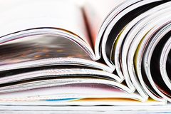 Old magazines with bending pages Stock Images
