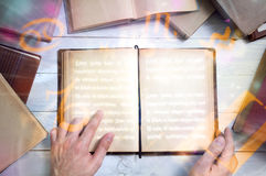 Old magic book with glowing zodiac symbols. And man`s hand shows important place royalty free stock images