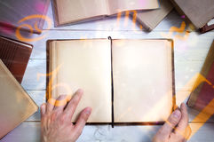 Old magic book with glowing zodiac symbols. And man`s hand shows important place. Empty page for your text stock photos