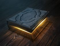 Old magic book on wooden table Royalty Free Stock Photography