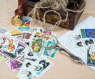 Old magnifier, stamp, postage stamps Royalty Free Stock Images