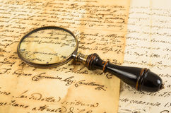 Old magnifying glass Stock Photos
