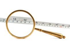 Old magnifying glass over the ruler Royalty Free Stock Photo