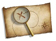 Old magnifying glass and pirates' treasure map Royalty Free Stock Photos