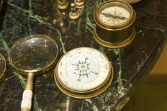 OLD MAGNIFYING GLASSES AND COMPASSES Stock Photo