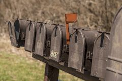 Old mail boxes. In a row royalty free stock image