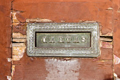 Old mail slot in a wooden door Royalty Free Stock Photography