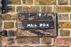 Old mailbox. An old mailbox on an old brick wall in warm sunset light Royalty Free Stock Image
