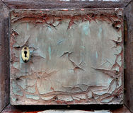 Old mailbox. The door of an old abandoned cracked mailbox Stock Photo