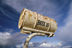 Old Mailbox. Rusty can mailbox, New Mexico Royalty Free Stock Photo