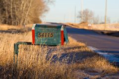 Old Mailbox. An old mailbox stationed on a rural road stock images
