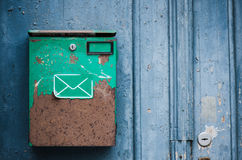 Old mailbox on a building wall, close-up Stock Photos