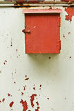 Old mailbox with the door peeling paint. Mailbox is a long but beautiful colors rust period Stock Photo