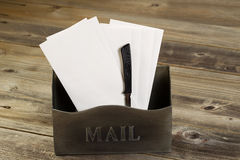 Old Mailbox filled with letters and opener Stock Photos