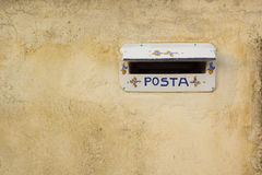 Old mailbox Italian. Old Italian mailbox on decrepit wall Royalty Free Stock Photo