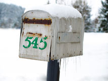 Old mailbox in winter Stock Photo