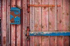 Old mailboxe on an old wooden door Stock Photos