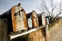 Old mailboxes in Midwest USA. Old vintage mailboxes in rural Midwest United States, late sun stock photography