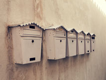 Old mailboxes on a wall. Horizontal photo Stock Photography