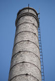 Old Main chimney. Italian Abandoned Factory chimney alone in the sky, with stairs Royalty Free Stock Images