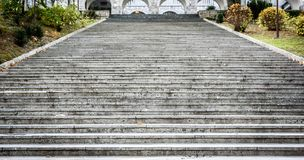 Old, majestic, grand, granite stone staircase leading to palace. Texture of giant stone steps leading to a ceremony venue Stock Photography
