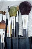 Old makeup brushes in holder. Old makeup brushes set in holder Royalty Free Stock Photography