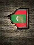 Old Maldives flag in brick wall. 3d rendering of a Maldives flag over a rusty metallic plate embedded on an old brick wall Royalty Free Stock Images