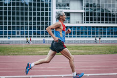 Old male athlete running. Chelyabinsk, Russia - August 28, 2015:  old male athlete running during championship of Russia on track and field athletics among the Stock Image