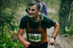 Old male athlete running. Zlatoust, Russia - August 30, 2015: old male athlete running during mountain marathon Race for the clouds, Zlatoust, Russia - August 30 Stock Photography