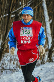 Old male athlete runs through forest Stock Photos